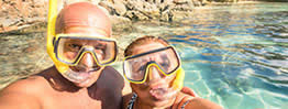 holiday makers in mask and snorkels
